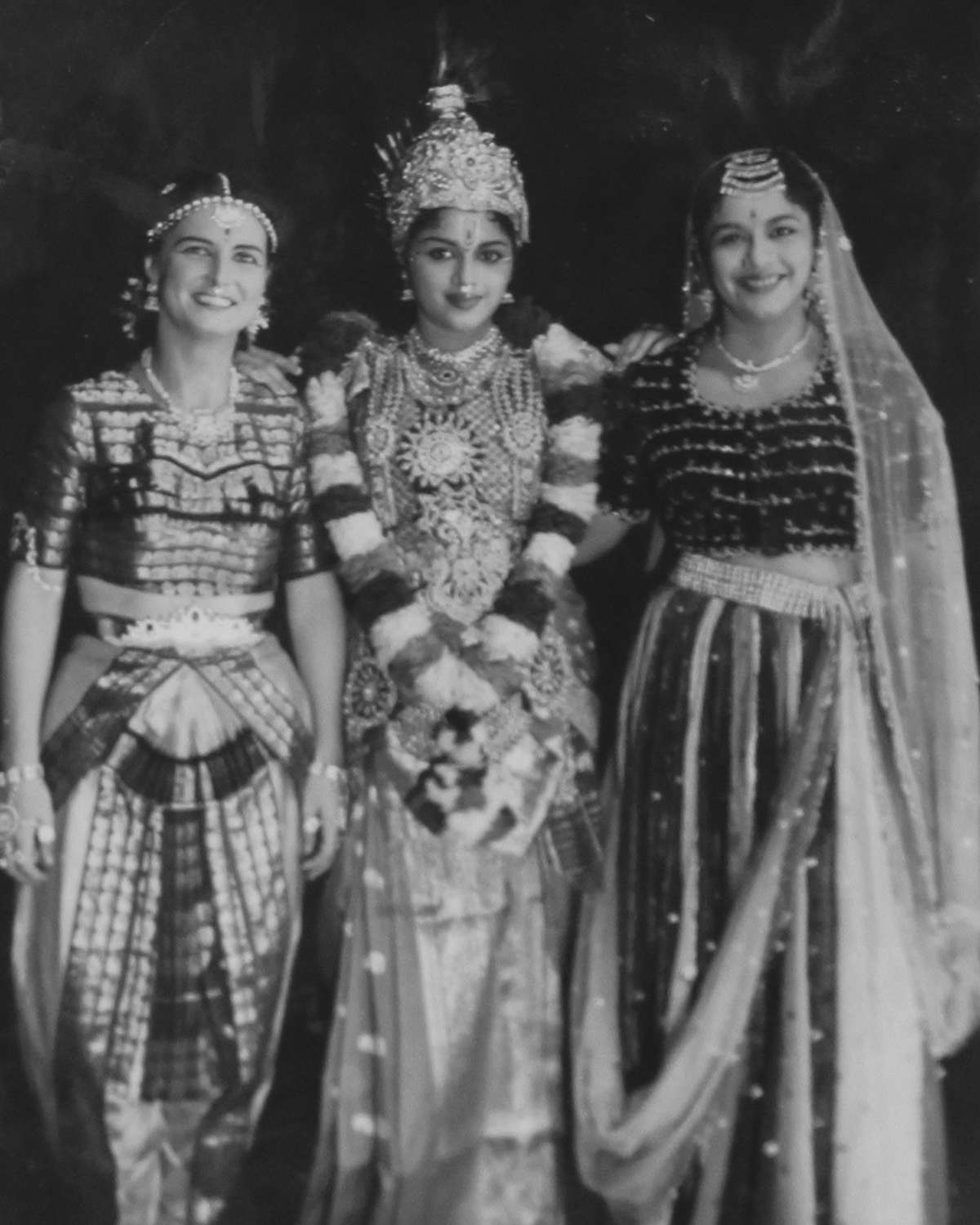 Left to right: my mom with Padmini and Lalitha, two of the three Travancore Sisters. They were hugely popular dancers and film stars, and our next-door neighbors in Chennai. My mother had trained as a ballet dancer, and took up Bharatanatyam, getting good enough to do a performance with them. More Travancore Sisters pictures are on my blog. Photo credit: Woodman Family Collection