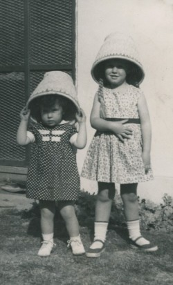 Youngest sister, Deborah, was born in Delhi. Deb and Jane decided these baskets were better as hats than as wastebaskets. Photo credit: Betsy Woodman
