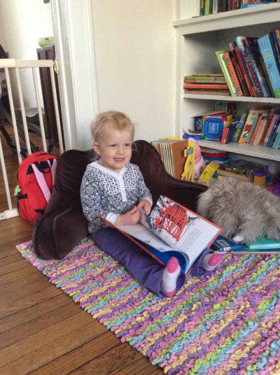 We're a family of readers. Granddaughter Clara started her book reviewing career at an early age. Photo credit Betsy Woodman