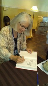 Signing books at FWS auction